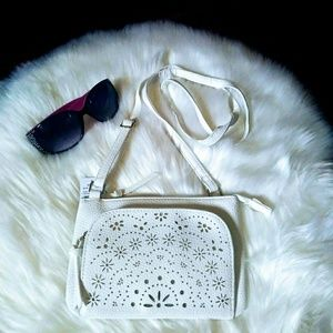 White crossbody purse.